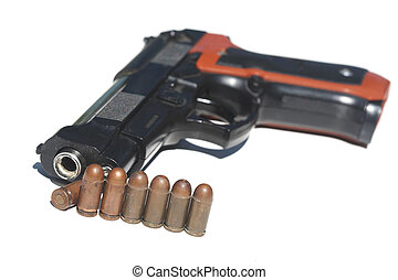 Pistol and ammunition on a white background