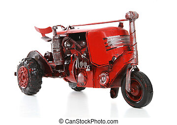 Old Retro Red Tractor - An old retro red tractor over a...