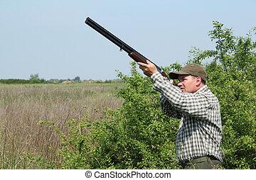 hunter hunting duck - hunter hunting wild duck