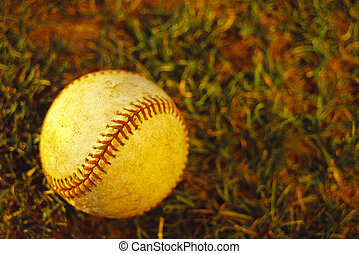 Baseball, concept photography - Baseball laying on ground in...