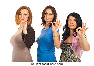 Group of women showing okay sign