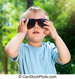 Boy Sunglasses in the summer park