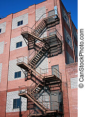 fire escape attached to a brick building