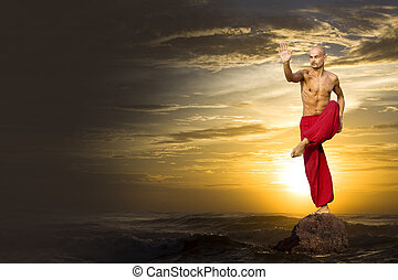 Martial Arts - Martial Artist in red practices at sunset