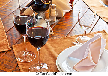 Served restaurant table - Pair of red wine goblets on served...