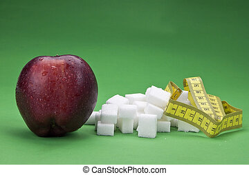 loosing weight - an apple against sugar cubes - healthy...