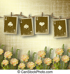 Old alienated cards on the wall in the room with flowers