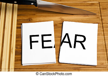 Knife cut paper with fear