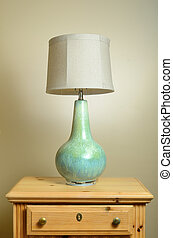 Endtable Lamp - A lamp on a wooden endtable.