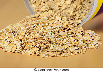 Oatmeal spilling out of bin. Selective focus on middle of...