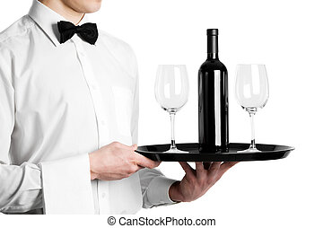 Waiter hands with wine bottle and stemware on tray - Waiter...