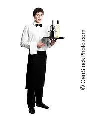 Waiter sommelier with bottles of wine and stemware on tray -...