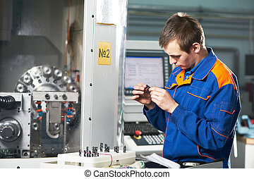 worker measuring detail - mechanical technician measuring...