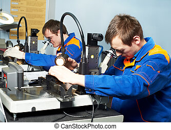 two workers at tool workshop - two workers technicians...