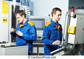 two workers at tool workshop - mechanical technicians...