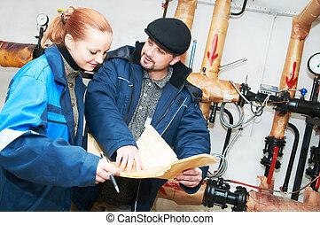 heating engineers in boiler room