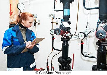 heating engineer in boiler room