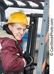 warehouse worker driver in forklift - young smiley warehouse...