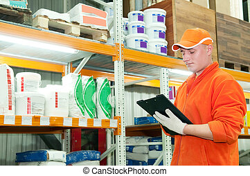 worker at warehouse - worker with cardboard at warehouse...