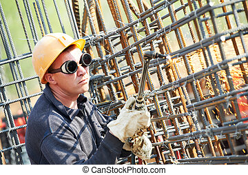 construction worker with flame cutting equipment - worker in...