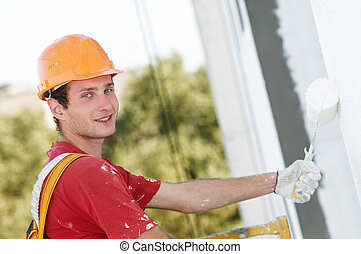 builder facade painter worker - Young smiling painting...