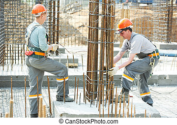 construction workers making reinforcement - builder workers...