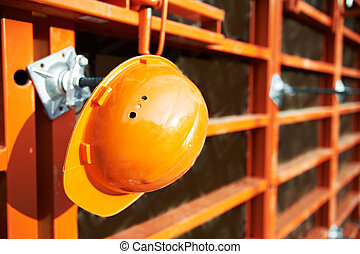construction site background - construction hardhat over...