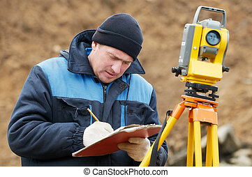 surveyor works with total station tacheometer