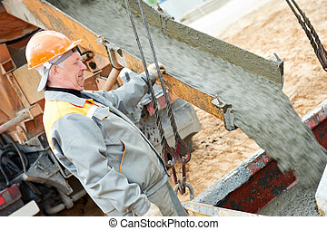 concrete pouring work - one builder worker in uniform and...