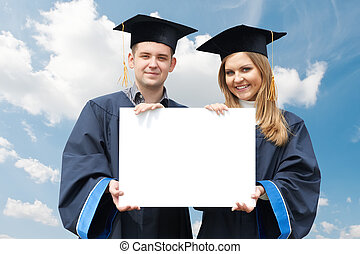 graduate students with white board - happy graduate students...