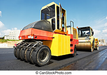 pneumatic asphalt roller at work - Pneumatic tyred roller...