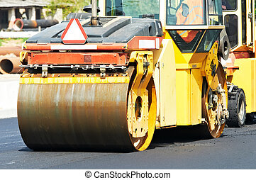 asphalt roller compactor at work - Heavy tandem Vibration...