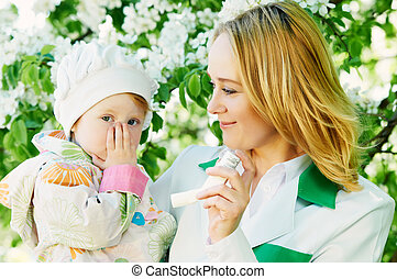 Baby and doctor with inhaler - Doctor and child during...