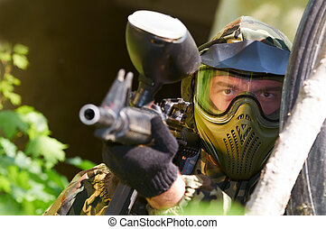 paintball player with gun - paintball sport player in...