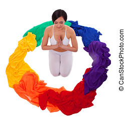 Full color of yoga chakra fabric rainbow - Young woman sit...