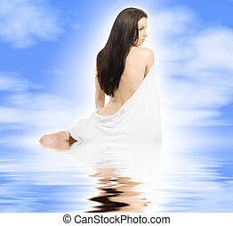Angelic - Beauty sits with towel blue sky with reflective...