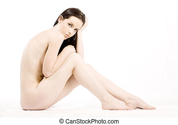 Implied nude - Brunette beauty nude on white studio...