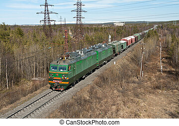 train on a background of high-voltage wires and meager...
