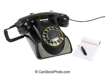 Vintage black telephone with memo pad isolated over white