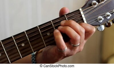 hand with guitar