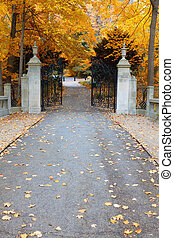 Park gates - Image of walking alley and gates in autumn park