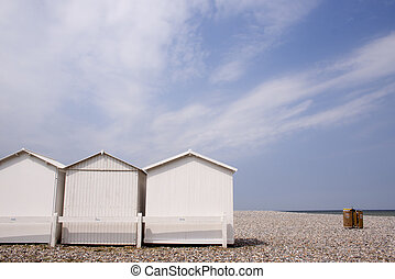 Beach-huts on flintstone along the coast