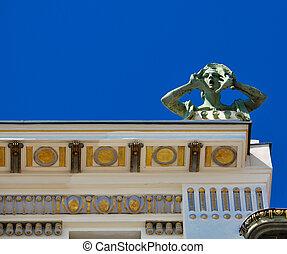 screaming art nouveau sculpture on a rooftop - bronze art...
