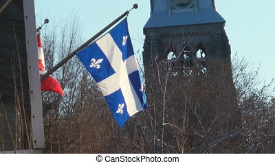Quebec Flag Flying On The Side Of An Office Building In...