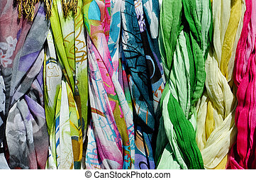 colorful scarves on a rack - a set of colorful scarves on a...