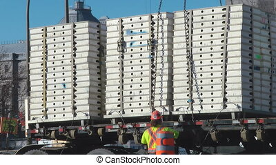 Rigging - Building Supplies Being Offloaded From An Eighteen...