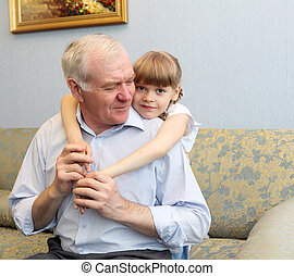 grandfather and granddaughter hugging - grandfather and...