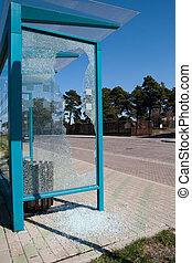 Broken bus stop - Damaged glass at a bus stop shed