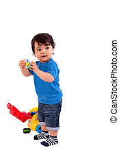 Beautiful and happy baby playing, on white background,...