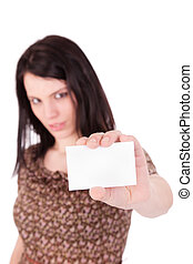 beautiful young woman with blank business card in hand, isolated on white background. Studio shot.